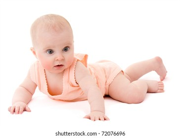 Surprised kid looks at a white background.