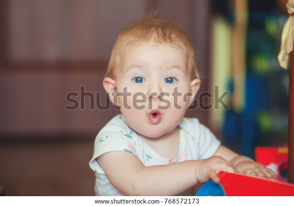 a56676e78 Surprised Kid Sitting Table Childs Eyes Stock Photo (Edit Now) 768572173