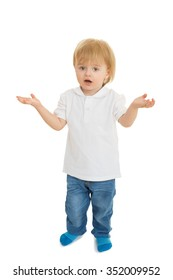 Surprised little boy throws up his hands - Isolated on white background