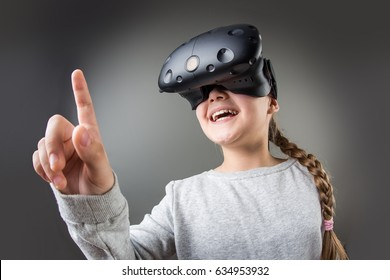 surprised little girl using a virtual reality headset