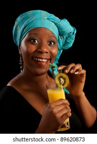 Surprised look on the face of a young african woman having a drink