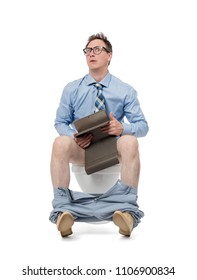 Surprised man in glasses, with tablet pc sitting on the toilet, isolated on white background. The concept of the situation