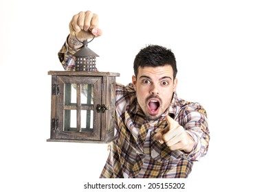 Surprised man with a lantern pointing you on a white background