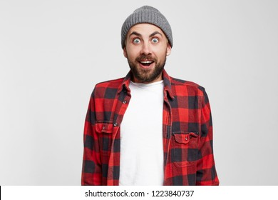 Surprised man with open mouth. Bearded man surprised with epiphany and sudden inspiration. Every inspiration is a fresh beginning. Unlock your potential. Studio photo over white background