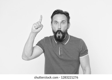 Surprised man with open mouth keep finger pointing up. Beraded man surprised with epiphany and sudden inspiration. Every inspiration is a fresh beginning. Unlock your potential.