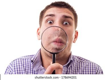 Surprised man through Magnifying glass