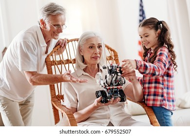 Surprised mature woman looking at toy