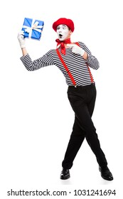 surprised mime pointing on gift box isolated on white
