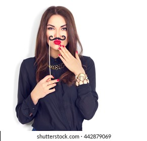 Surprised model Girl holding funny mustache on stick isolated on a white background.