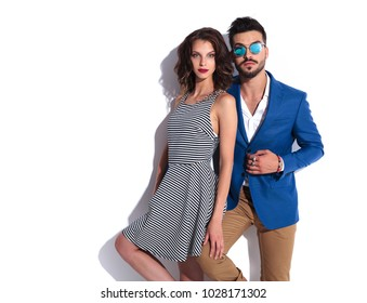 surprised modern man posing with his woman on white background