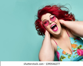 Surprised overweight fat woman  happy laughing smiling screaming having good time crazy shopping sale on popular blue mint background
