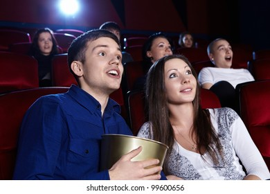 Surprised people in the cinema