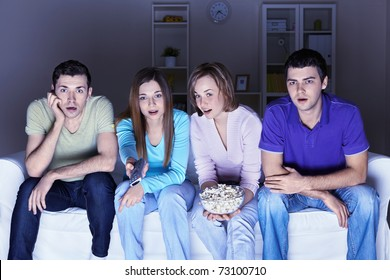 Surprised people are watching a movie