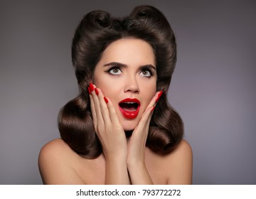 Surprised pin up girl holds cheeks by hand. Comic woman with curls retro hairstyle. Wow. Presenting your product. Beauty salon.