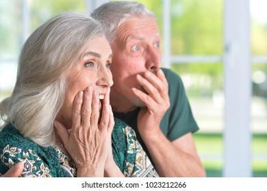 surprised  senior couple
