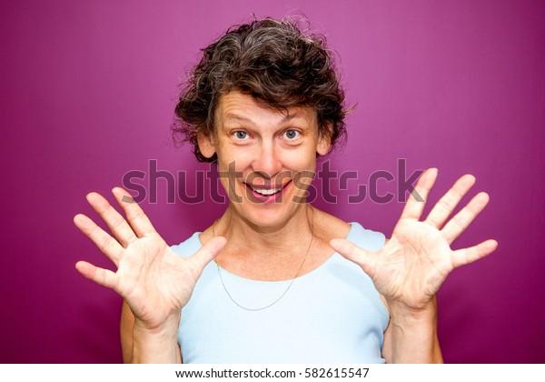Surprised senior woman showing stop gesture