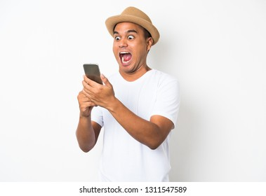 Surprised and shocked asian man looking smartphone