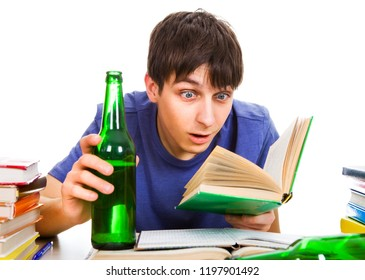 Surprised Student with a Beer read a Book on the School Desk Isolated on the White Background