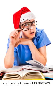 Surprised Student in Santa's Hat with Magnifying Glass on the White Background