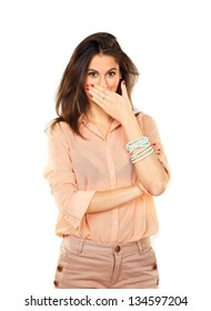 Surprised stylish young woman using her hand to cover her mouth