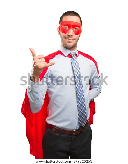 Surprised super businessman doing a call gesture