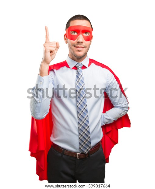 Surprised super businessman pointing up