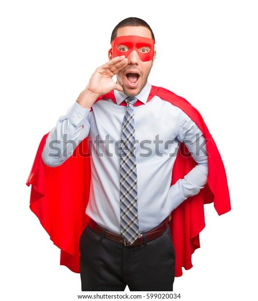 Surprised super businessman shouting