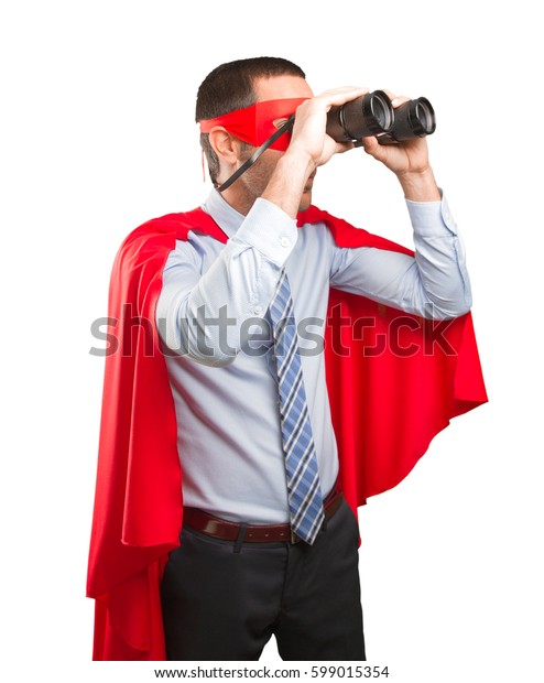 Surprised super businessman using a binoculars