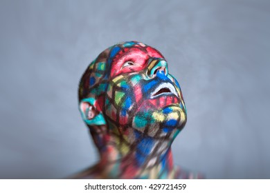 Surprised Superhero portrait, colorful face art with tilt shift and motion blur effect.
