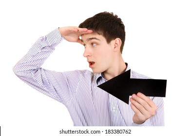 Surprised Teenager with Black Arrow Isolated on the White Background