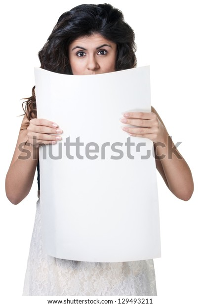 Surprised woman behind blank sign over white background
