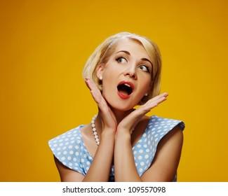 Surprised woman in blue dress
