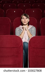 Surprised woman at the cinema