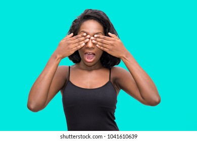 Surprised woman covers eyes