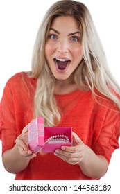Surprised woman discovering necklace on a box