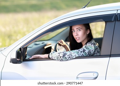 surprised  woman driving her car