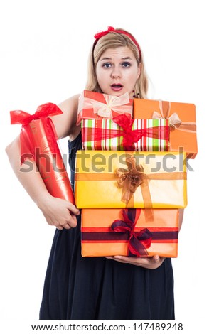 Surprised woman holding many gift boxes, isolated on white background.