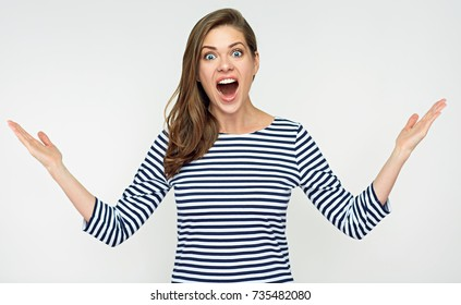 Surprised woman makes a choice with two raising hands up. Isolated portrait.