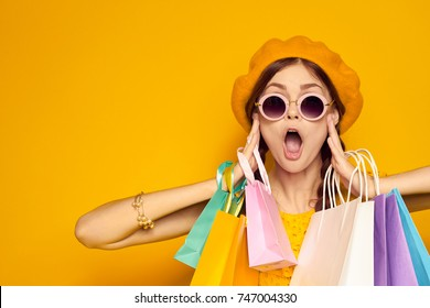 surprised woman, multicolored packages, buy, shopping