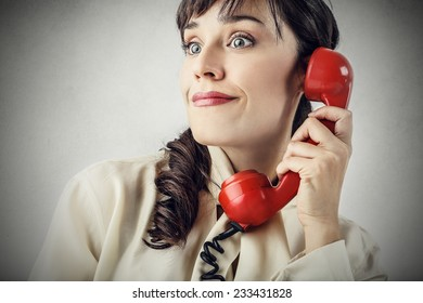 Surprised woman at the phone