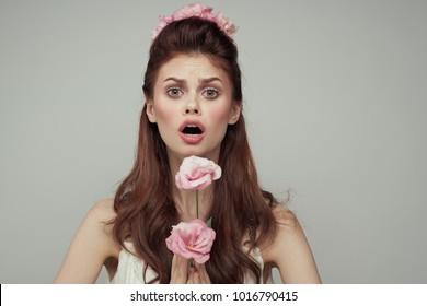 surprised woman with pink flowers, beauty, floristics