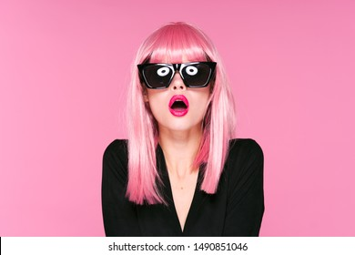 surprised woman pink lips wig on her head black glasses dark clothes doll