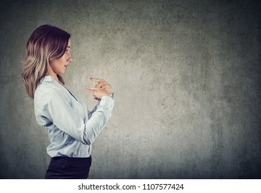 Surprised woman pointing fingers at herself denies responsibility and accusations being misunderstood