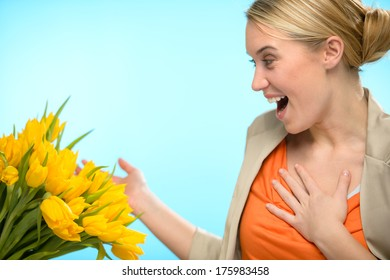 Surprised woman receive bouquet of yellow tulip flowers spring