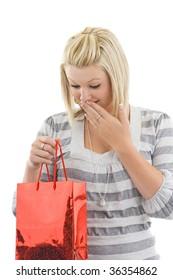 Surprised woman with shopping bag,on white background.