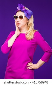 surprised woman in sun glasses and clothes