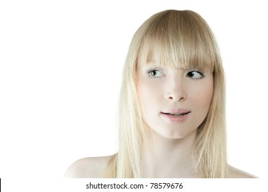 Surprised young blond woman looking sidewards
