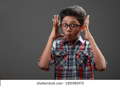 Surprised young boy of Indian origin