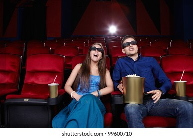 Surprised young couple in a movie theater