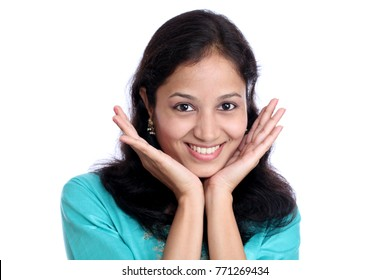 Surprised young Indian woman against white background